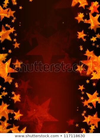 golden Christmas star over red background radiate Stock photo © marinini