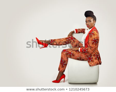 fashion woman sitting with her hands on the knees Stock photo © feedough