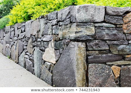 Natural rock retaining wall in a garden Stock photo © ozgur