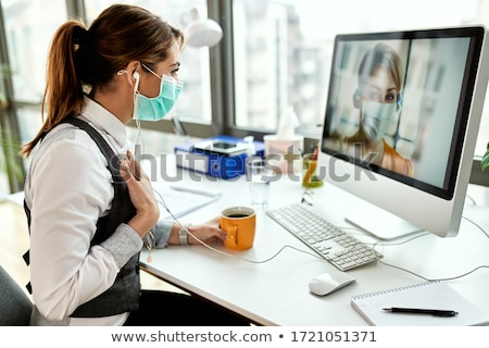 Young worker woman having coffee in her office Stock photo © nenetus