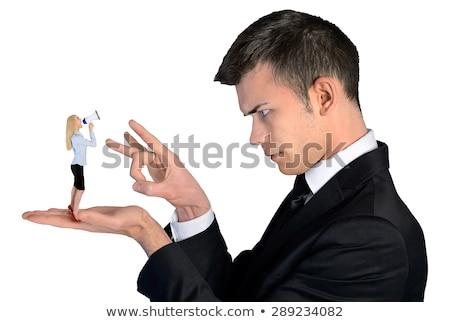 Business woman finger flipping on little man Stock photo © fuzzbones0
