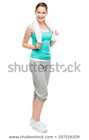 full length portrait of pretty girl enjoying stretching stock photo © deandrobot