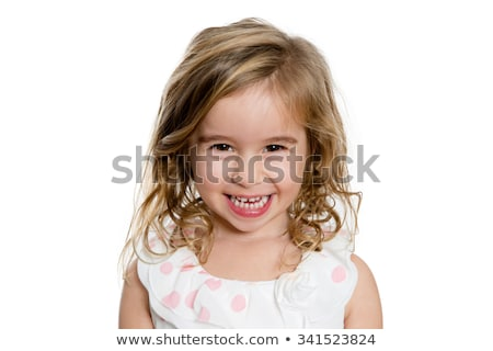 cute blond girl smiling to you genuinely stock photo © ozgur