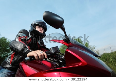 motorcyclist standing on country road, bottom view Stock photo © Paha_L