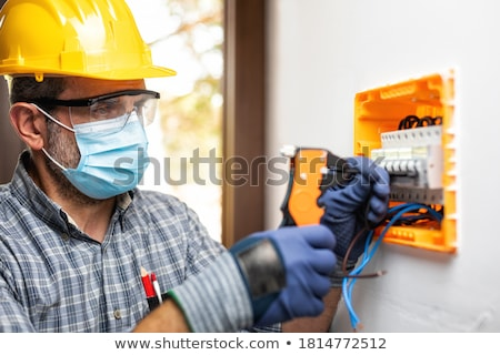electrician hands with multimeter and wires stock photo © lightkeeper