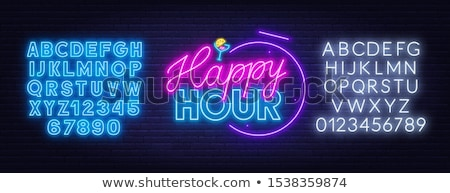 neon sign on a brick wall   happy hour stock photo © zerbor