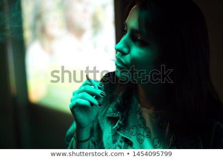 Femme éclairage cigarette noir cheveux beauté Photo stock © deandrobot