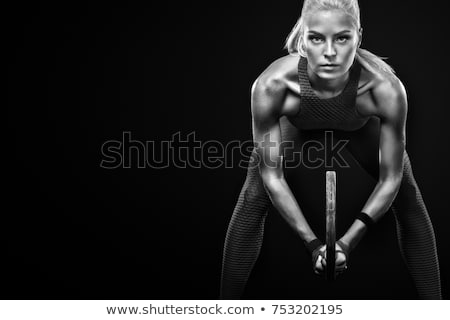 The body of young athletic girl on a dark background Stock photo © restyler