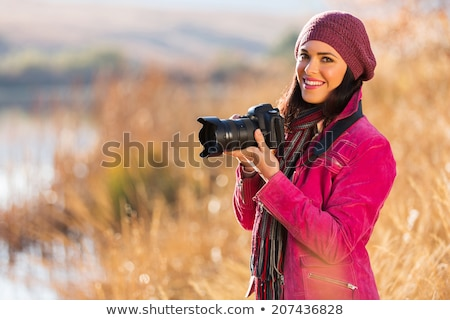 Photographer girl with dslr camera Stock photo © svetography