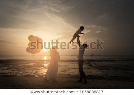 Silhouette of a Muslim family, parents with kids dreaming of new Stock photo © zurijeta