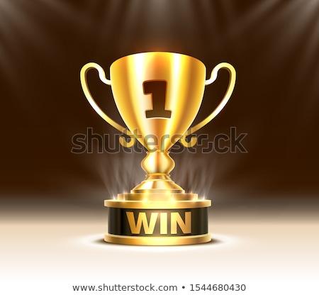Golden Trophy Cup on Podium Stock photo © timurock