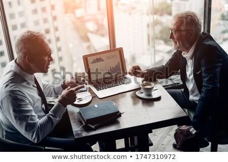 dwa · biznesmenów · posiedzenia · biuro · lobby · mówić - zdjęcia stock © deandrobot