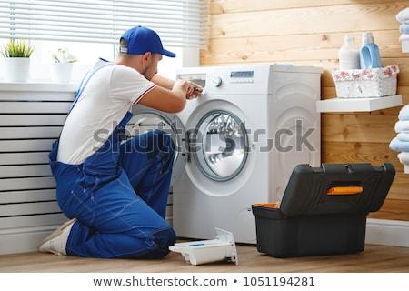 Repairman is repairing a washing machine  Stock photo © papa1266
