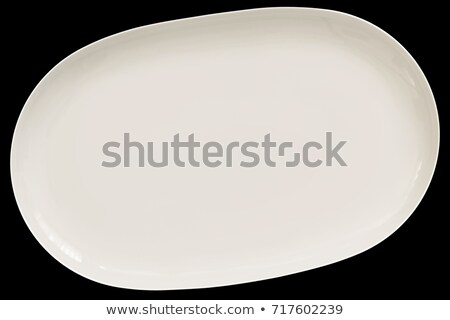 Oval blanco cerámica plato aislado Foto stock © Digifoodstock
