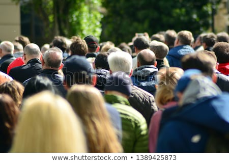 Stock photo: Defocused crowd attending political meeting