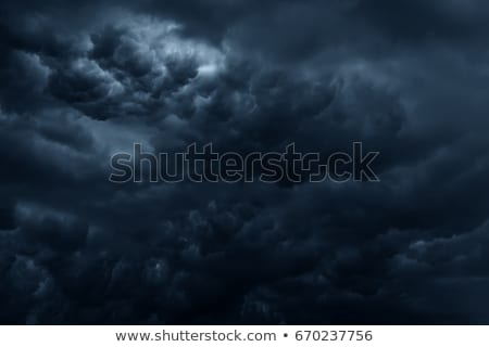 Stormy weather and dark clouds Stock photo © konradbak
