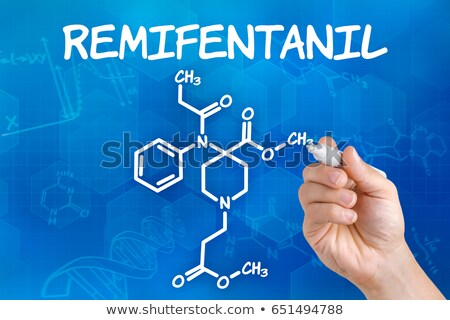 Hand with pen drawing the chemical formula of Remifentanil Stock photo © Zerbor