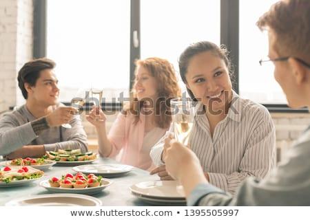 Foto stock: Dos · mujeres · fiesta · sonriendo · alimentos · mujeres