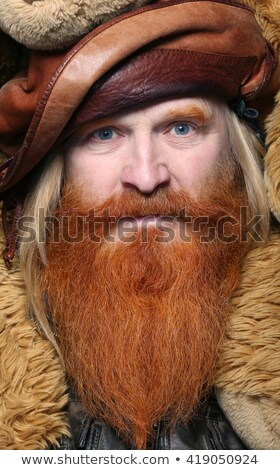 Smiling red bearded man studio portrait on dark background Stock photo © julenochek