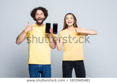 happy casual couple showing phones and man makes ok sign Stock photo © feedough