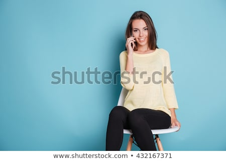 beautiful girl on black chair looking at camera Stock photo © julenochek