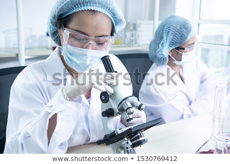 Stock photo: Lab assistant and veterinarian examining tissues sample from a c