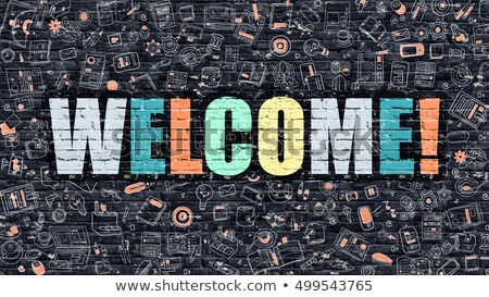 Multicolor Welcome on Dark Brickwall. Doodle Style. Stock photo © tashatuvango