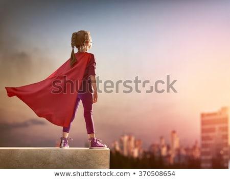 Stok fotoğraf: Kız · oynama · süper · kahraman · mutlu · heyecanlı · atlama