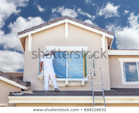 Man with contractor in front of house Stock photo © IS2