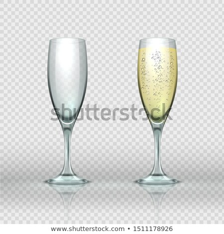 Champagne two full flutes or glasses white sparkling wine and christmas candle. Winter holiday card  Stock photo © Iaroslava