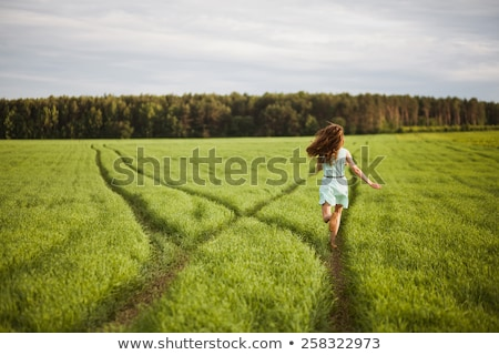 woman running in field of high grasses Stock photo © IS2