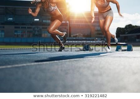 2 female athletes in starting blocks Stock photo © IS2