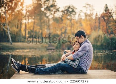 пару вместе док женщину романтика сидят Сток-фото © IS2