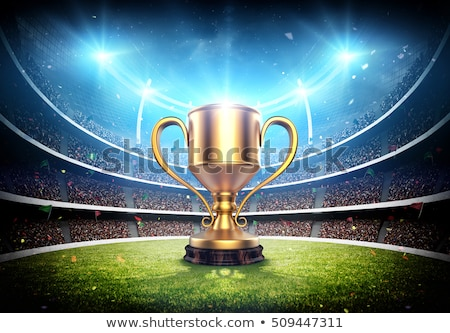 Golden champion cup on green background Stock photo © studioworkstock