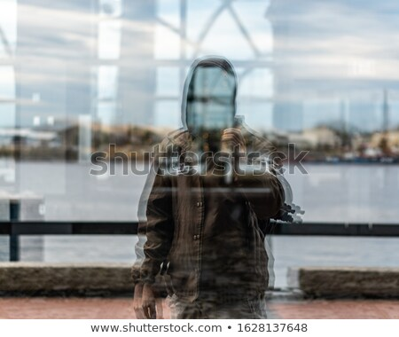 Man working out in front of mirror Stock photo © IS2