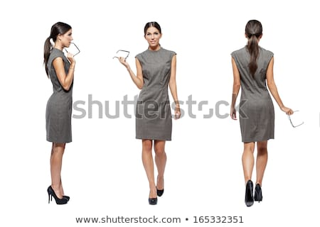 Stock photo: side view of happy brunette businesswoman with high heels