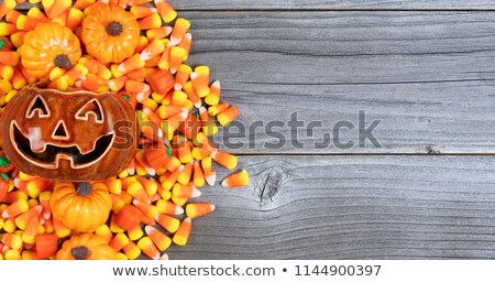 halloween candy treats on weathered wood in flat lay format with stock photo © tab62