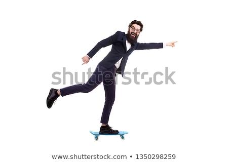 The businessman riding skateboard isolated on white background Stock photo © Elnur