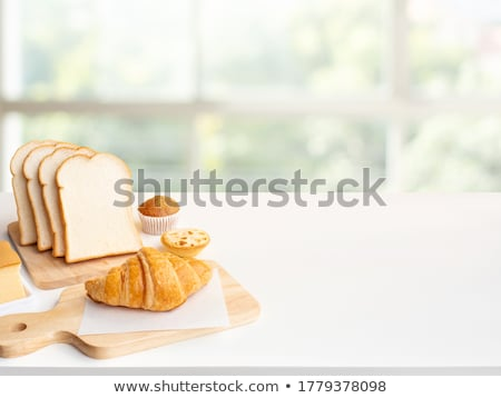 Fresh croissants on chopping board Stock photo © dash