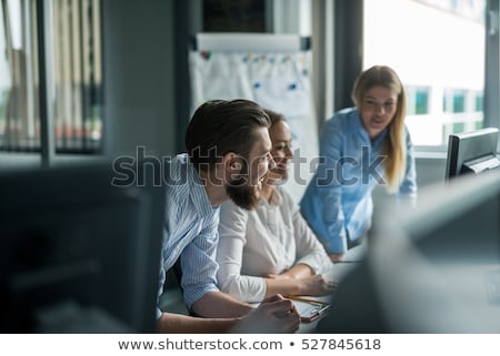 happy creative female worker at office stock photo © dolgachov