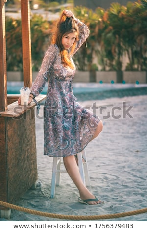young asian fashion woman drinking cocktail in a beach bar stock photo © artfotodima