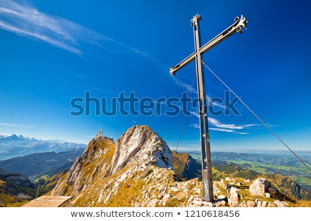 Pilatus mountain peak iron cross view stock photo © xbrchx