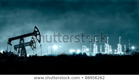 Pump jack and refinery at night. Stock photo © EvgenyBashta