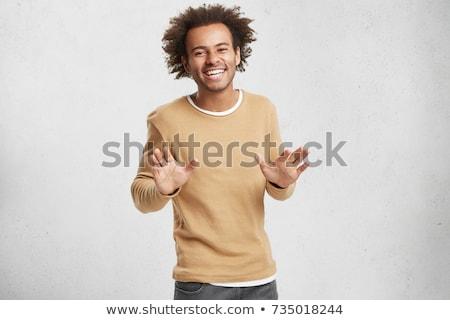 Retrato joven suéter bufanda aislado beige Foto stock © deandrobot