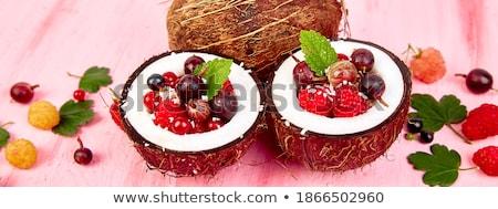 Stock photo: Fruit salad agrus, gooseberry, rasbberry in coconut shell bowl