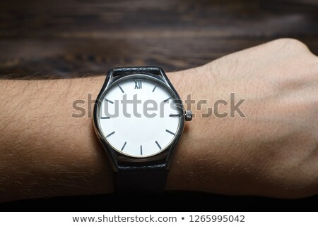 man with a clock without hands