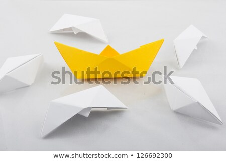 Saving a sinking paper boat Stock photo © moses