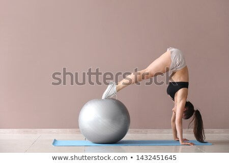 young woman doing workout with fitness ball stock photo © andreypopov