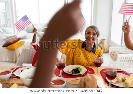 Side view of a multi-generation family having wine on dining table at home Stock photo © wavebreak_media