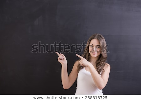 Smiling nerd pointing on the empty board Stock photo © majdansky